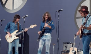 Glenn Frey, centre, with Randy Meisner, left, and Bernie Leadon performing with the Eagles on the Helen Reddy Show, 1973.