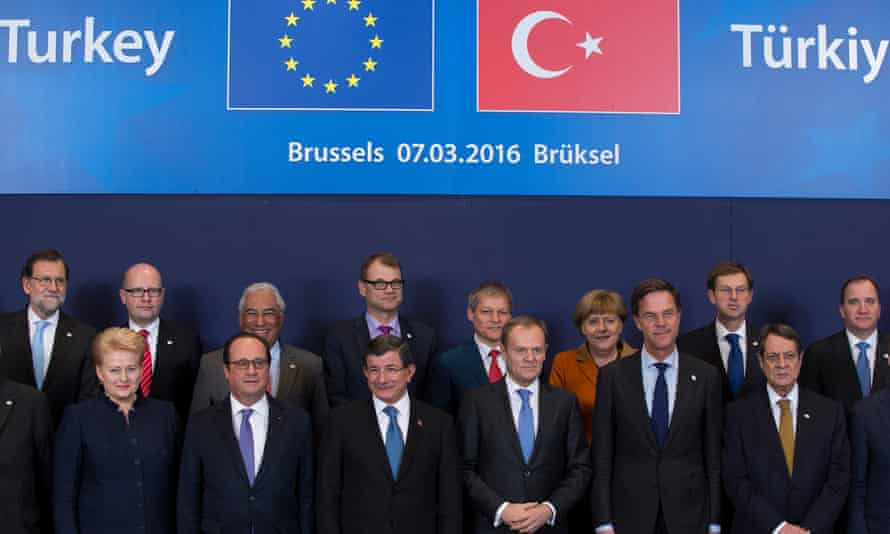 Turkish prime minister Ahmet Davutoğlu poses with European Union leaders during the summit in Brussels,