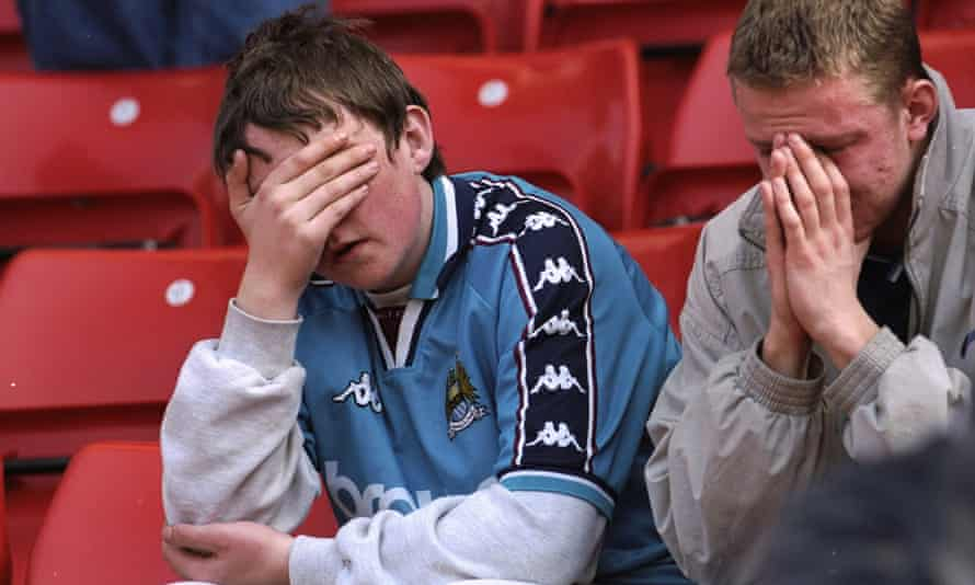 A pair of City fans sit in despair at Stoke City's Britannia Stadium after the club were relegated to Division Two in May 1998.