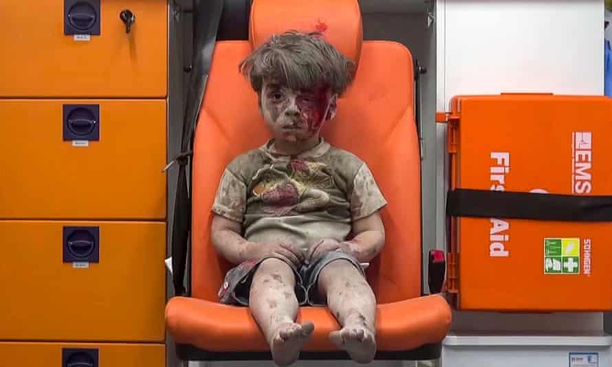 In this still taken from video provided by Aleppo Media Centre, a child sits in an ambulance apparently after being pulled out of a building hit by an airstrike.