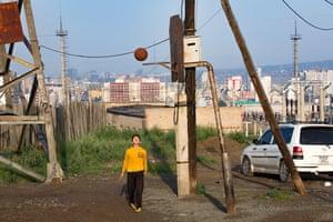 A boy plays basketball in the Bayanzürkh district of Ulaanbaatar