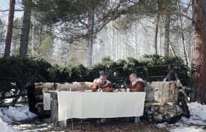 Shoigu and Putin sit down for a meal and drinks in the forest.