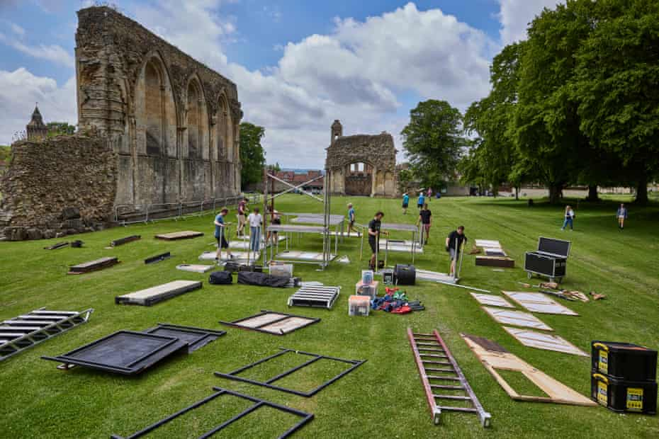 The 'Get-in' at Glastonbury Abbey in Somerset. Each day the actors arrive at their new venue at 1pm and spend roughly 2 hours setting up the entire stage and backstage area.