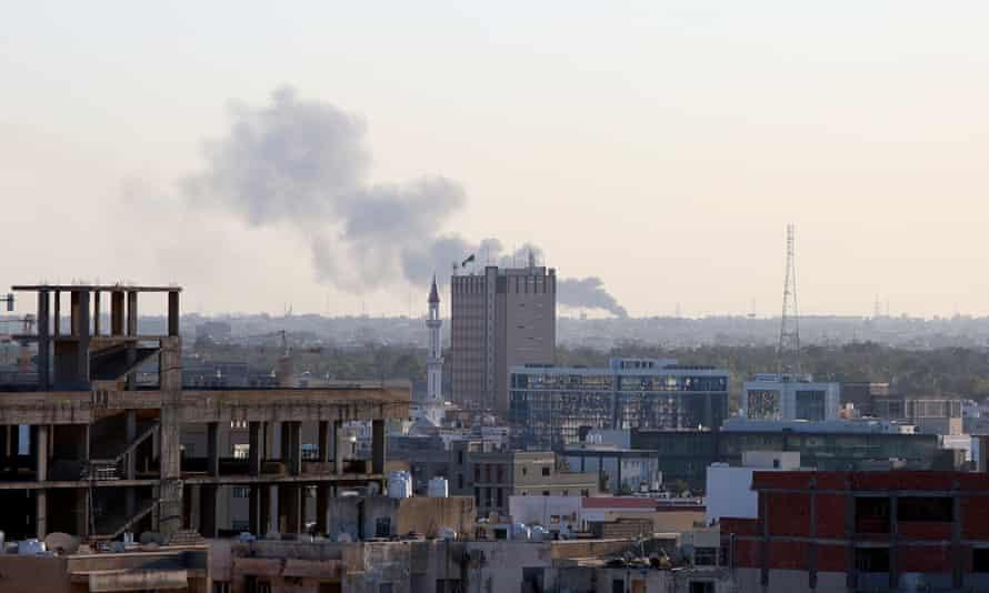 Smoke rises over Tripoli