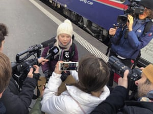 Greta Thunberg talks to journalists as she arrives in Zurich, Switzerland on 23 January for the World Economic Forum