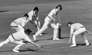 Northamptonshire fielder Roy Virgin fails to catch the ball off the bat of Bob Willis of Warwickshire during the County Championship match between Warwickshire and Northamptonshire at Edgbaston in September 1975.