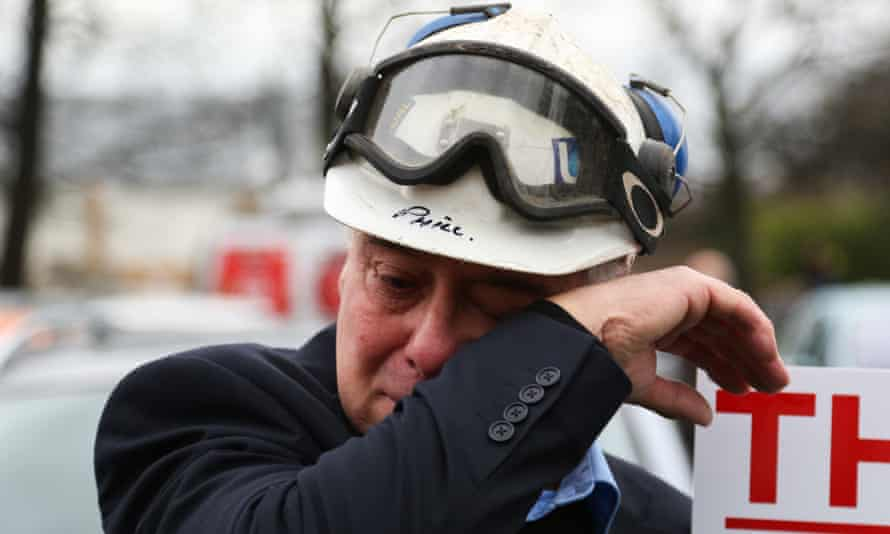 A former miner sheds a tear during the  march