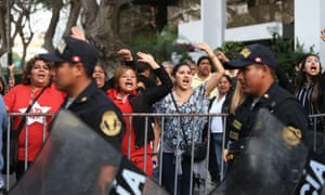 People protest in Lima against the former president Alan García's request for asylum in Uruguay.