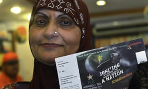 A cricket fan holds tickets for the Pakistan v Zimbabwe series.