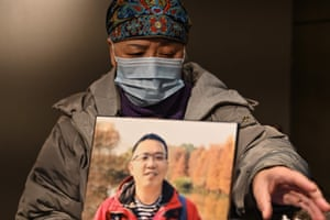 Zhong Hanneng with a portrait of her son who died from Covid-19 in Wuhan. Zhong still struggles to sleep or eat following the death of her son from the disease nearly 10 months ago, and says friends and relatives are shunning her family amid lingering fears of infection. One year after the coronavirus began spreading from the city, Zhong and other Wuhan next-of-kin are no nearer to closure as the Chinese government's refusal to take responsibility for its role in the outbreak compounds the struggle of coming to terms with her loss.