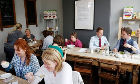 Customers at the Saltaire Canteen, Saltaire, Yorkshire, one of the many Real Junk Food cafes nationwide. Diners pay whatever they feel the food is worth.