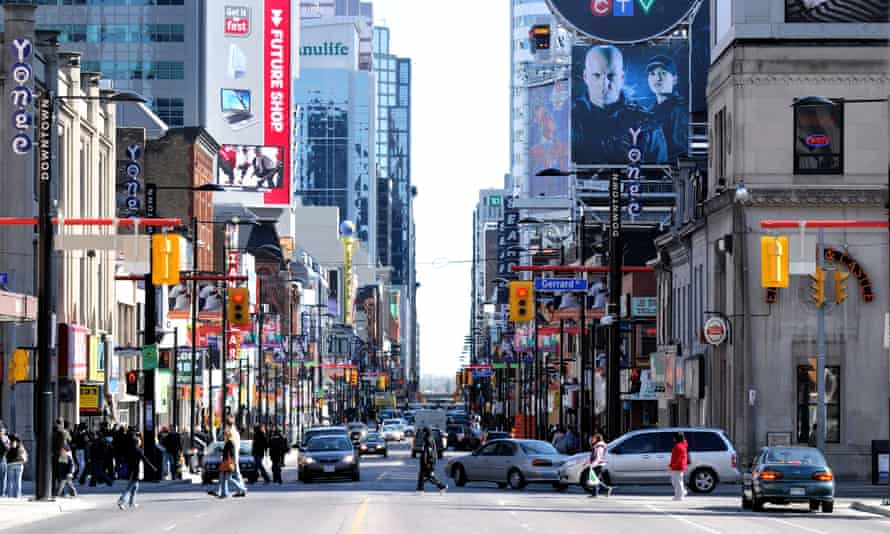 'Dominated by multistorey facades of bright corporate advertising' ... the intersection of Yonge Street and Dundas Street in Toronto.