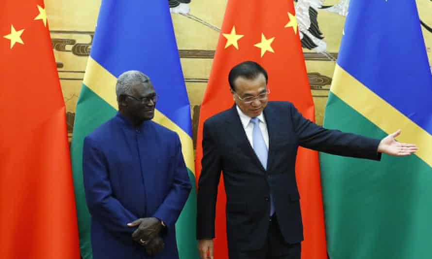 Solomon Islands Prime Minister Manasseh Sogavare, left, and Chinese Premier Li Keqiang in the Great Hall of the People in Beijing, shortly after Solomon Islands switched allegiance from Taiwan to China.
