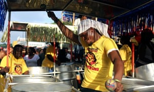 A man plays the steel pan in the J'Ouvert parade ahead of the West Indian Day parade.