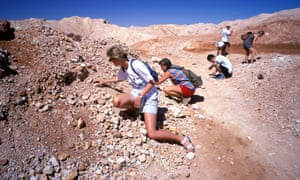 Tourists fossicking for opals.