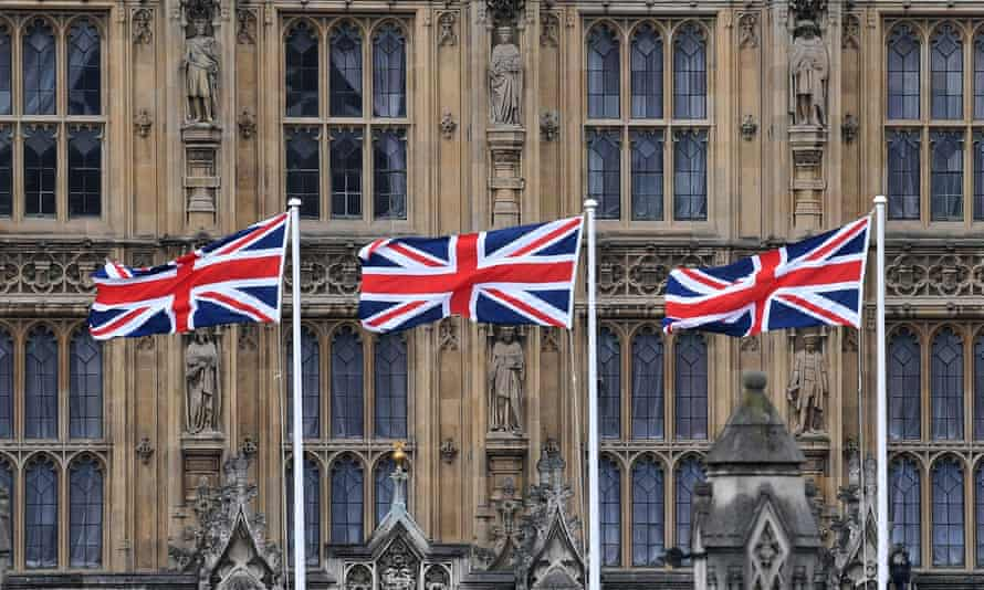 Union flags flutter outside the Palace of Westminster