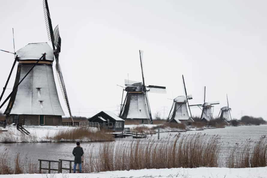 Snow blankets a field in the Dutch village of Kinderdijk.