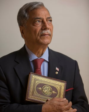 Chaudry holding his copy of the Qur'an.