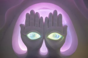 6 Feeling suite, gazing eyes greet you, looking down from a pair of enormous hands.