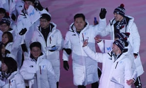 Members of the unified Korea delegation take selfies during the parade