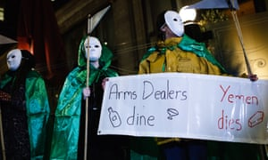 Activists protest outside a function held by the Aerospace, Defence and Security Group in London.