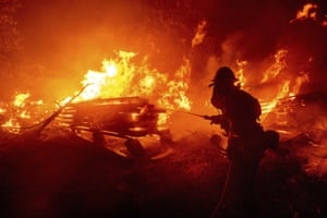 A firefighter battles the Creek fire in Madera county, California on 7 September.