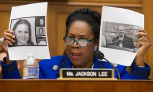 Democratic Representative from Texas Sheila Jackson Lee holds up the images of Leigh Corfman, Wendy Miller, Debbie Wesson Gibson and Gloria Thacker Deason, all of whom have accused Roy Moore of sexual misconduct, in Washington on Tuesday.