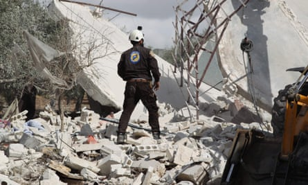 A member of the Syrian White Helmets searches for victims of a Russian airstrike that hit the village of Jaballa on 2 November 2019.