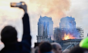 An onlooker films the Notre Dame Cathedral fire.