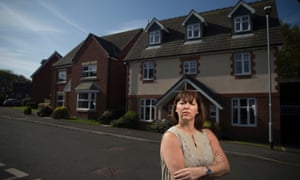 Jo Darbyshire outside her now almost unsaleable new-build Bolton home.