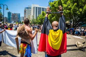 A demonstrator raises shackled hands during a protest against deaths in custody of Indigenous Australians at the 2014 G20 summit.