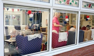 A worker and residents of the Amberwood care home in Wigston, Leicester.