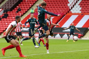 Bamford jumps to head home the opening goal.