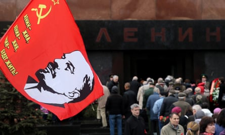 Russians lay flowers at Lenin's mausoleum in Moscow's Red Square.
