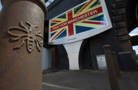 A Manchester bee on one of the city's bollards.