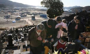 Relatives visit their family's grave in Iwate prefecture on the sixth anniversary of the Fukushima meltdown this month.