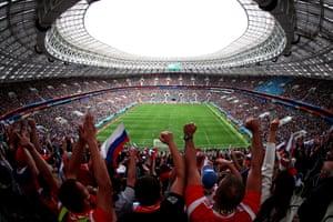 Russian fans celebrate Yuri Gazinskiy's opening goal as Russia beat Saudi Arabia 5-0 at the Luzhniki Stadium