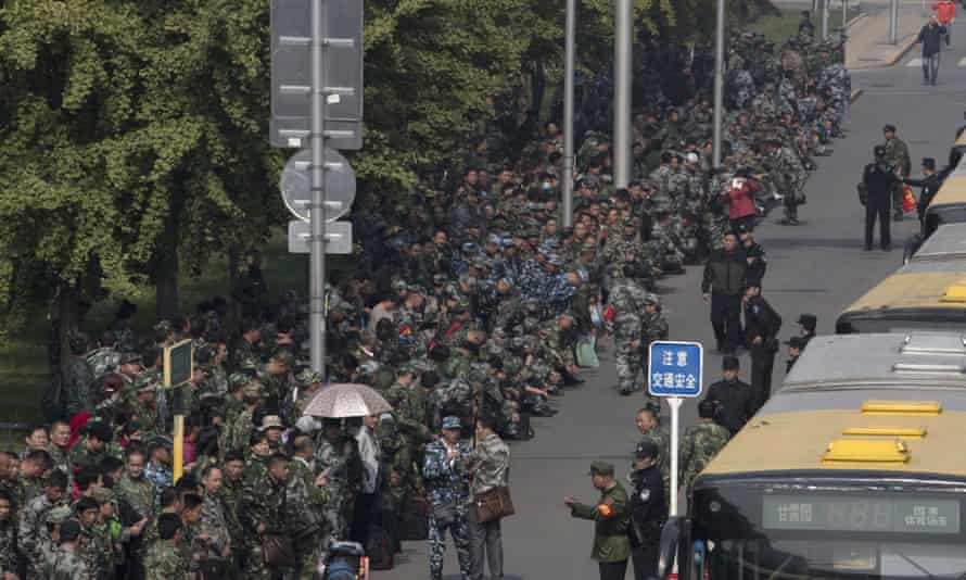 Hundreds of protesters outside the Chinese defence ministry in Beijing