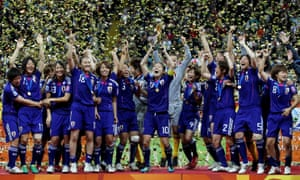 Homare Sawa lifts the World Cup after Japan's shootout win over the US