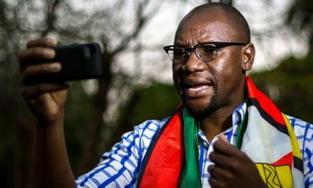 Zimbabwean cleric Evan Mawarire recording an instalment of his #ThisFlag video series.