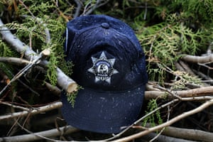 This Oct. 16, 2019 photo, shows a cap of one of the state police officers who were shot or burned to death in their vehicles, in El Aguaje, Mexico. Thirteen state police officers were shot or burned to death in their vehicles.