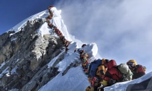 Climbers queue on a ridge on Mount Everest in May