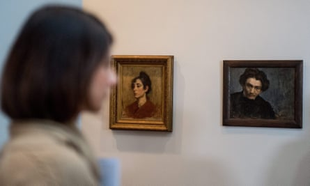 Look and learn: a woman examines a painting.