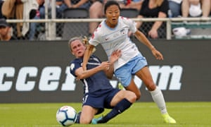 Chicago Red Stars' Yūki Nagasato and North Carolina Courage's Heather O'Reilly challenge for the ball in the first-half