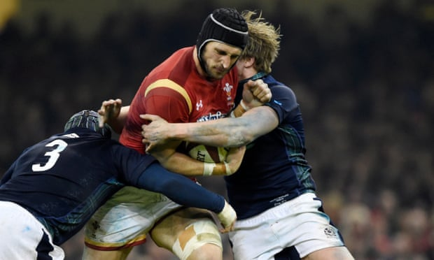 Luke Charteris of Wales is tackled by Scotland's WP Nel and Jonny Gray