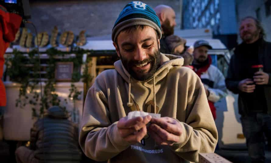 A man rolls a joint during a 'Wake and Bake' legalised marijuana event in Toronto.