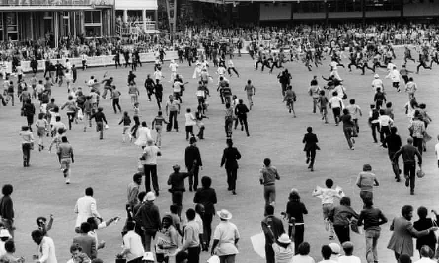 West Indies fans rush on to the ground after West Indies beat England by 92 runs in the World Cup final at Lord's in June 1979.