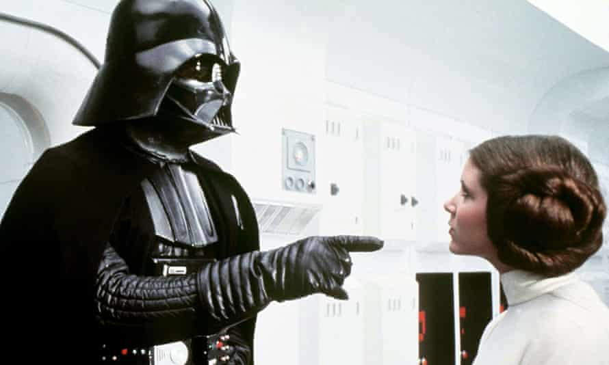 David Prowse and Carrie Fisher in Star Wars (1977).