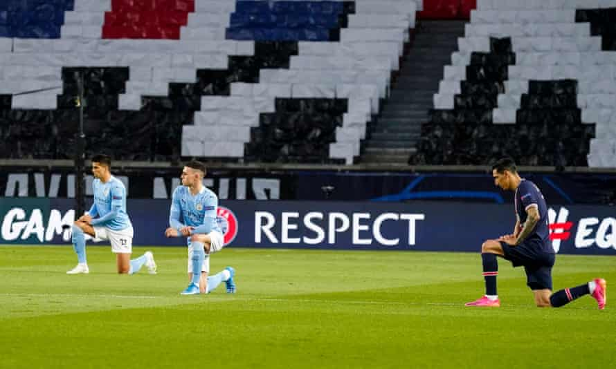 Paris Saint Germain and Manchester City players take the knee ahead of their Champions League semi-final on Wednesday