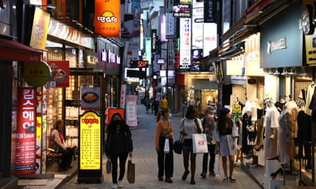 People walk along the street in face masks on May 06, 2020 in Seoul, South Korea.